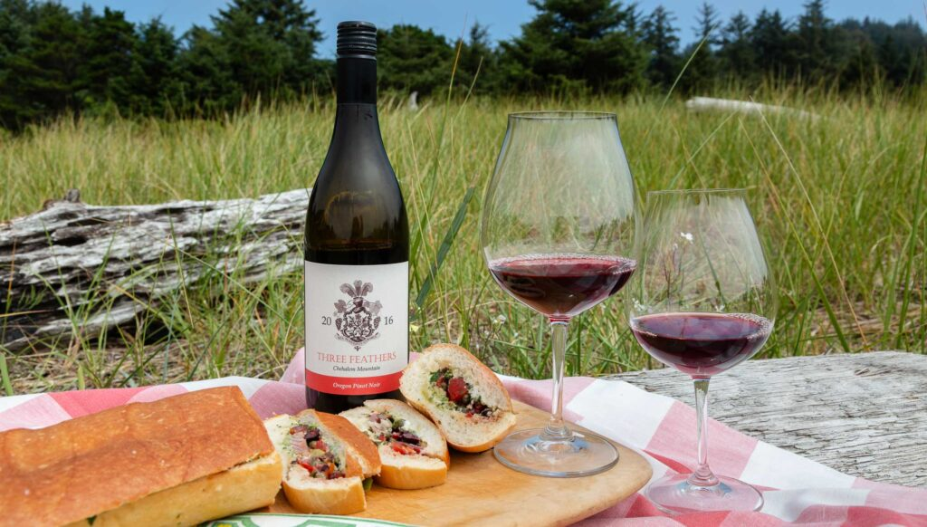 Oregon Coast picnic with Pan Bagnat and Three Feathers Pinot Noir. The 'Pan Bagnat' is a traditional local sandwich NICE Alpes-Maritimes French Riviera Provence-Alpes-Côte d'Azur France